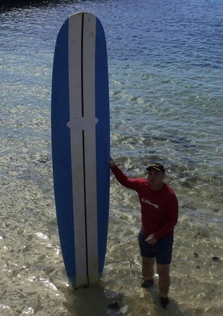 Kai Sallas' Pro Surf School Hawaii: Posing with my long surf board after training