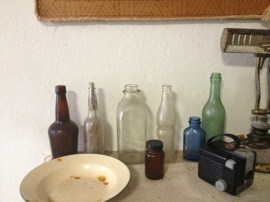 Tuna Point Lighthouse: Collection of bottles.Look the old milk bottle at center