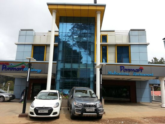 Ponmari Residencyy: Front view showing hotels main entrance, restaurant entrance and parking area.