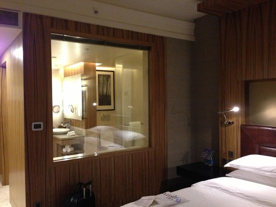 Sheraton Grand Bangalore Hotel at Brigade Gateway: A bathroom window overlooking your bed.
