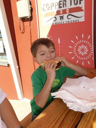 Coppertop BBQ: Thomas munching on the burger! He said it is better than Pasta Bolognese (now that's a complimen