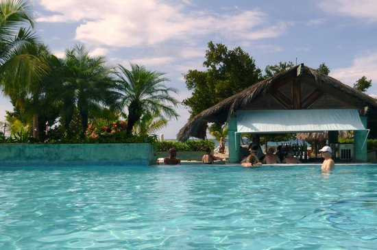 Couples Negril : Pool bar with ocean in background.