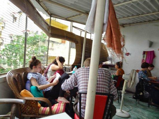 Aum Cafe upstairs dining area Varanasi Assi Ghat