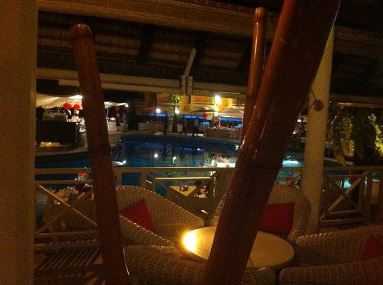 Merville Beach Hotel : View of pool from bar at night