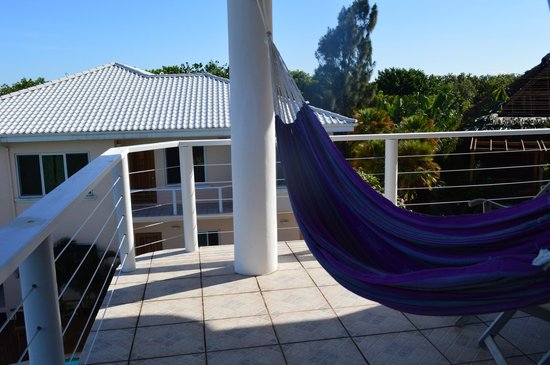 Laru Beya Resort & Villas: Looking south from the Jabiru 303 balcony to the next building past the pool.