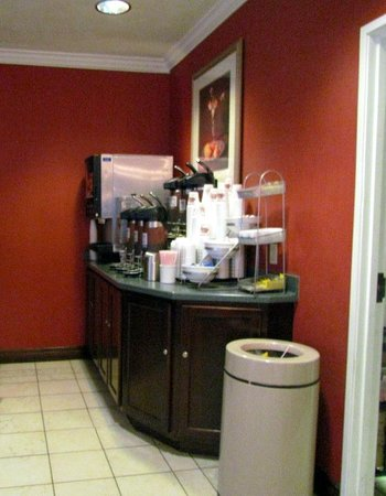 Comfort Suites: coffe,juice area at breakfast.