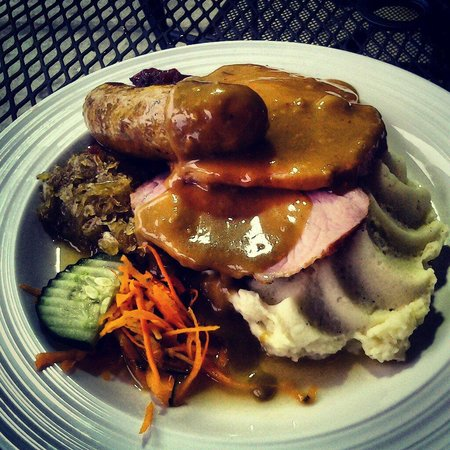 Taste of Berlin: Dual plate of bratwurst and pork loin with mashed potatoes and kraut. Delicious!