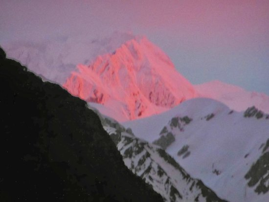 Misty Peaks: Sunset on Mt Cook as seen from room (East view, magnified)