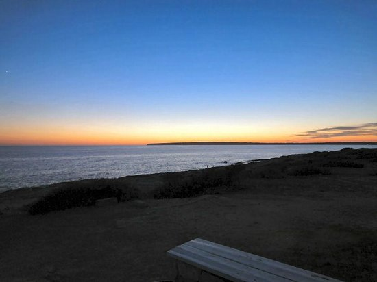 Ses Clotades: Sonnenuntergang am Strand
