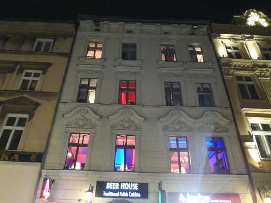 Greg & Tom Beer House Hostel: The lights show that, althought the party is happening on the 1st floor, there are people zzz...