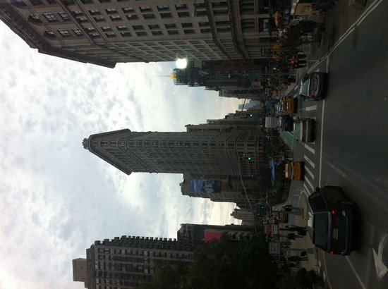 Flatiron Building from upstairs on a double-decker bus.