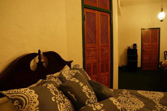 The Hacienda: Comfortable new bedding, carved wooden doors