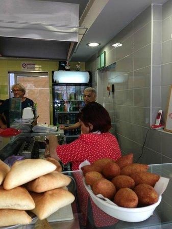 Falafel Hwadi Micheal: Yvette serving falafel