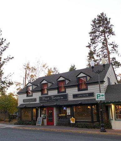 Pine Tavern Restaurant: Dining Room tree above the restaurant roof