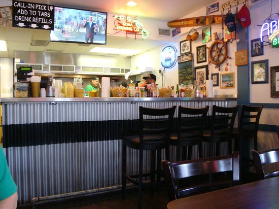 Fish Shack: Inside of restaurant---open kitchen behind bar.