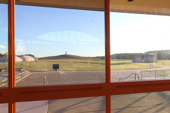 Wright Brothers National Memorial: Monument through window of visitors center