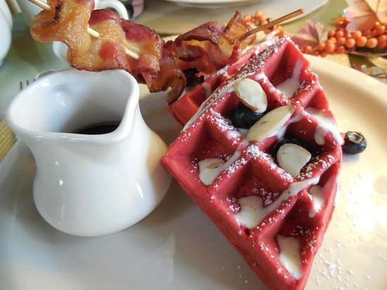 Agustin Inn: Red Velvet Waffle with Blueberries, Almonds and Bacon