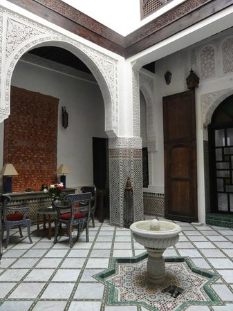 Algila Fes: Beautiful mosaics and scrollwork on archways