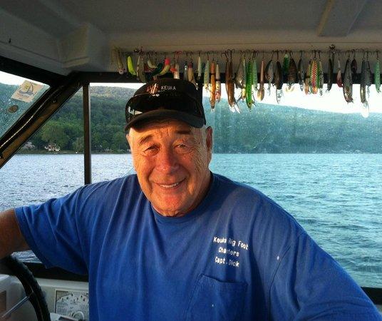 Keuka Big Foot Charters - Tours : Capt. Dick at the helm