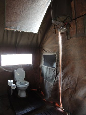 andBeyond Savute Under Canvas: En-suite with bucket shower
