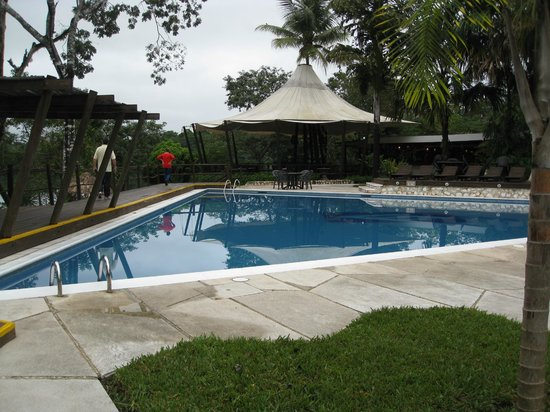 Villa Maya: The deeper pool with restaurant in the background