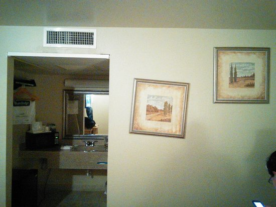Travelodge Riviera Beach/West Palm: pictures were hanging wrong and crazy glued to the wall.  See the mold in the air vent!