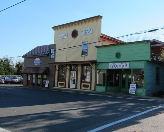 Thornton River Grille: Front view with Thorton River Grill restarant, brown building on the left, market in center, and