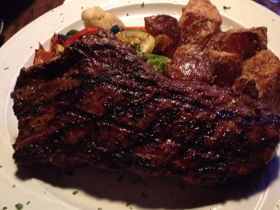 Melrose Grill: Bone in steak, fabulous! Those are the crispy Parmesan potatoes everyone raves about!