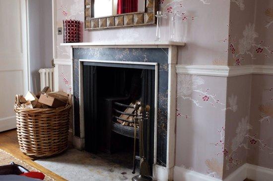 Babington House: Bedroom fireplace