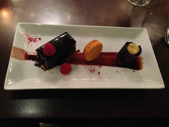 Ananda Restaurant: Dark chocolate mousse, coffee glazed nutty brownie with passion fruit sorbet cylinder