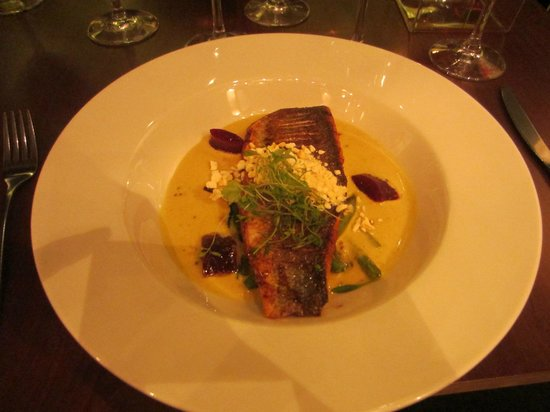 Ananda Restaurant: Pan seared sea bass fillet with coconut & raw mango sauce, tempered curry leaves, yellow mustard