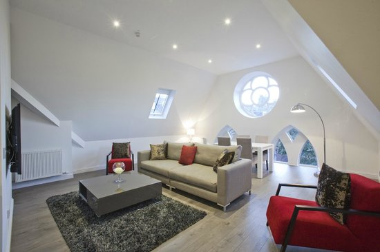 Apple Apartments Aberdeen: Each apartment provides ample natural light pouring in through the charming church windows