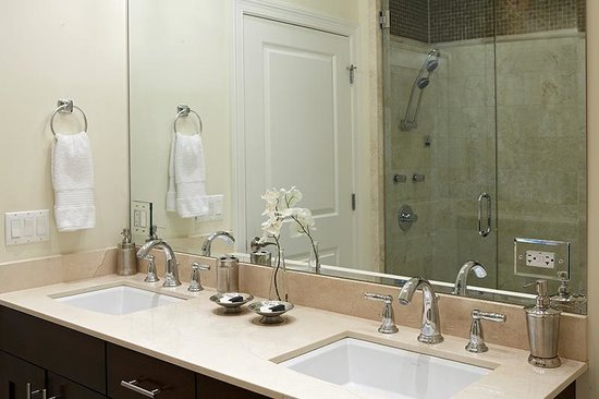 The Guesthouse Hotel : The master bathroom of each suite features two vanities.