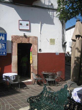 el Chahuistle: outdoor tables, kitchen inside doorway