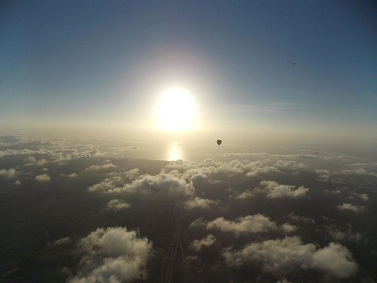 Sky's the Limit Ballooning Adventures: sun just prior to going down with balloons Nov 17 2013