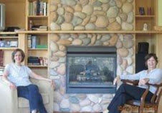 By the Bay Bed and Breakfast: Your host and guest in front of the fireplace