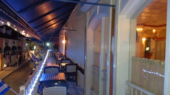 Athena Cafe & Bar: Side of verandah with seating
