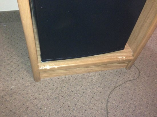 Days Inn & Suites Madison: This is a picture of the fridge and to me it looks like a dog chewed the bottom of the unit