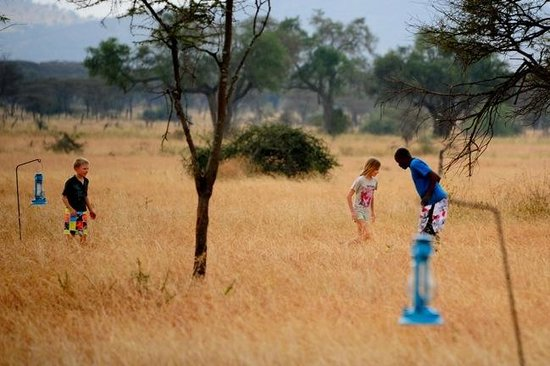 Kati Kati Tented Camp: Playing football (soccer) in the cut grass of the Serengeti