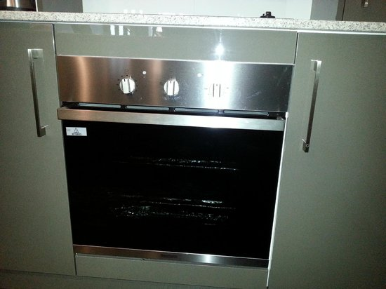 Gallery Apartments : Oven and there is a dishwasher and microwave also
