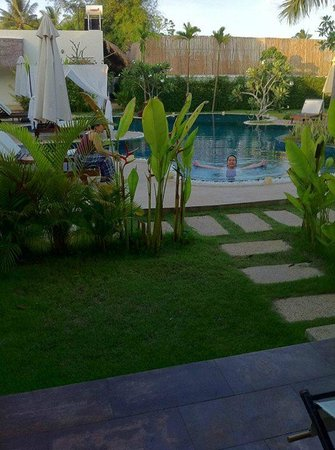 Navutu Dreams Resort & Wellness Retreat: My aunt and hubs enjoying time in the fresh water pool!!