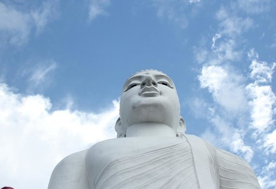 Bahiravokanda Vihara Buddha Statue: Buddha's head against blue sky