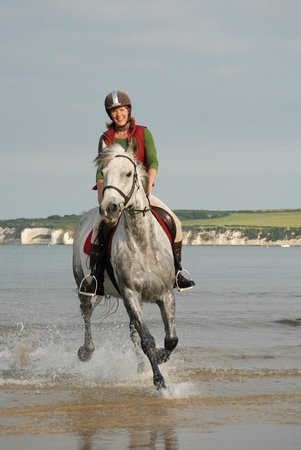 Studland Stables: Helen riding Hattie on Studland Beach.