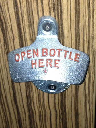 Travelodge Manchester Central Arena : bottle opener on the end of the desk 11/13