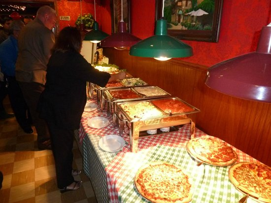 Frantones Pizza & Spaghetti Villa: My aunt Maria is first to dig in.  Plenty of food left over after seconds.