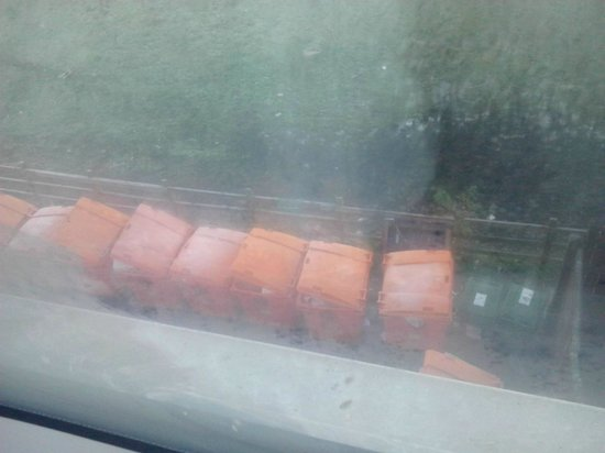 Premier Inn Newcastle (Metro Centre) Hotel: These Dumpsters were directly below our window - not good in summer!!