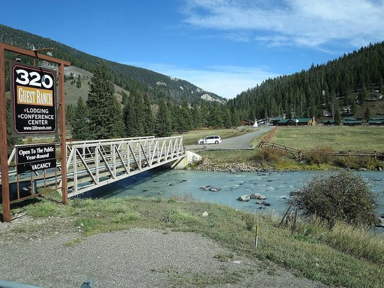 320 Guest Ranch: bridge crossing to the ranch