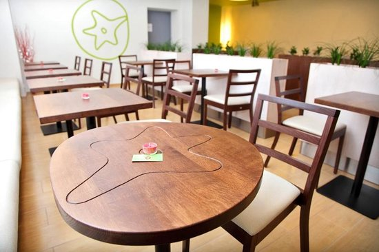 caf style section with masive wooden furniture picture of tomato rh tripadvisor com
