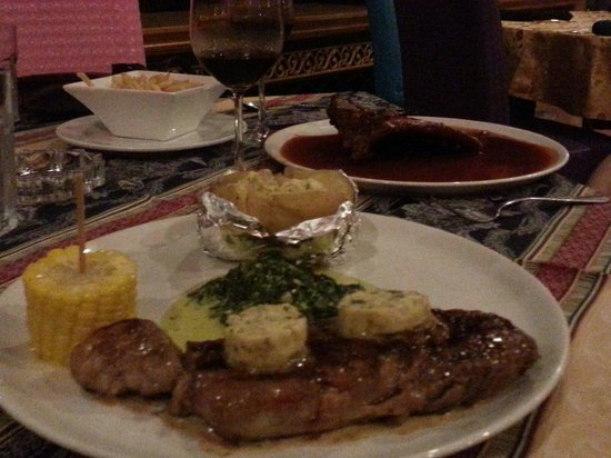 Norbu's Steakhouse: great food and the wine is priced teasonably. go for it!