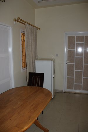 Aldiyar Hotel : dinner table and fridge